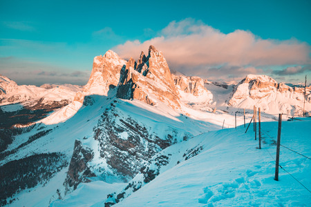 Classic view of famous Seceda mountain peaks in the Dolomites illuminated