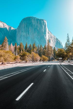 Famous El Capitan mountain peak with road running through Yosemite Valley