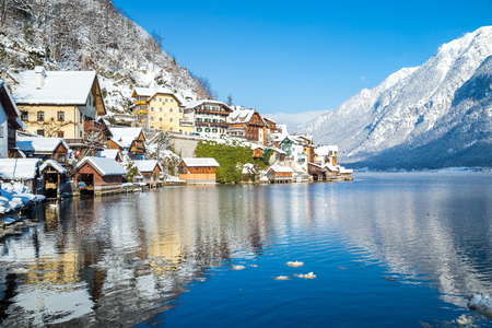 Traditional houses in famous Hallstatt lakeside town on a beautiful cold sunny day in winter, Salzkammergut region, Austria