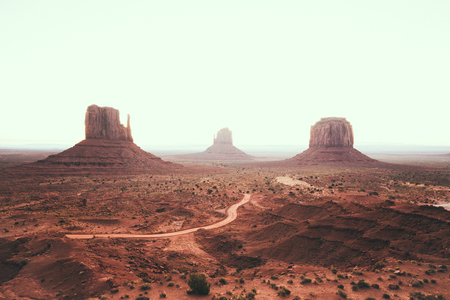 Classic view of scenic Monument Valley with the famous Mittens and Merrick Butte in summer