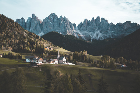 Beautiful view of idyllic mountain scenery in the Dolomites with famous Santa Maddelana mountain village 版權商用圖片