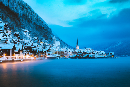 Panorama view of famous Hallstatt lakeside town in the Alps in mystic twilight Stock Photo