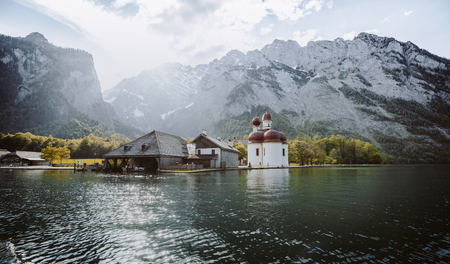Classic panoramic view of Lake Konigssee with world famous Sankt Bartholomae pilgrimage church and Watzmann mountain