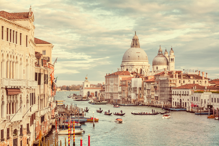 Classic panoramic view of famous Canal Grande with scenic Basilica di Santa Maria della Salute in beautiful golden evening 写真素材 - 113996692
