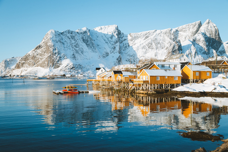 Beautiful view of scenic Lofoten Islands archipelago winter scenery with traditional yellow fisherman Rorbuer cabins