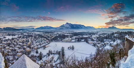 Panoramic view of the historic city of Salzburg from famous Hohensalzburg Fortress in winter