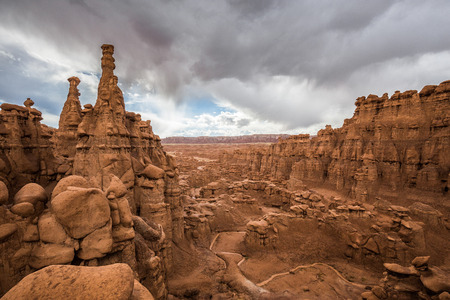 Panoramic view of beautiful amidst hoodoos sandstone formations in Goblin Valley State Park during a summer thunder, Utah, USA