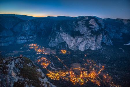 Panoramic aerial birds eye view of famous Yosemite Valley illuminated in beautiful post sunset twilight 写真素材