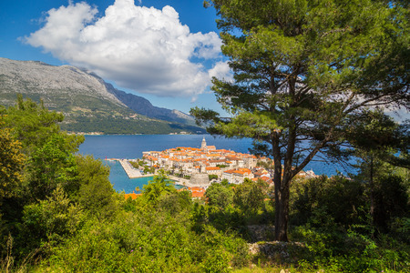Beautiful view of the historic town of Korcula on a beautiful sunny day with blue sky and clouds in summer