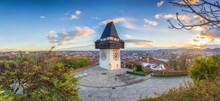 Classic panorama view of the historic city of Graz with famous Grazer Uhrturm clock tower