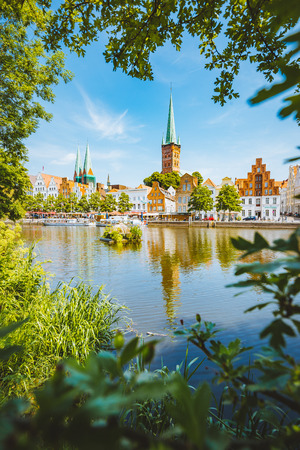 Classic panorama view of the historic city of Luebeck with famous Trave river in summer, Schleswig-Holstein, Germany Stock Photo - 119003295