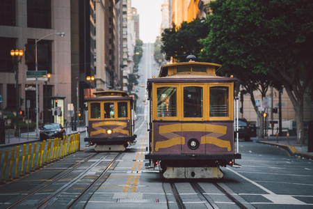 Classic panorama view of historic San Francisco Cable Cars on famous California Street at sunset with retro vintage style filter effect, central San Francisco, California, USA