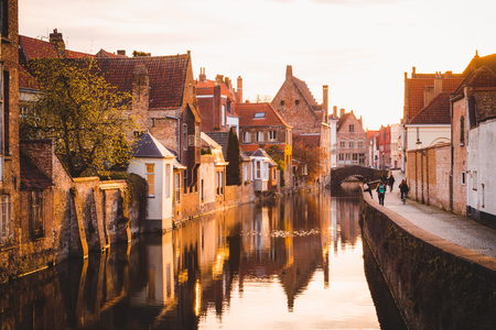 Scenic view of the historic city center of Brugge in beautiful golden morning light at sunrise, province of West Flanders, Belgium Stock Photo