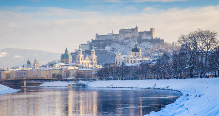 Classic view of the historic city of Salzburg with Salzach river on a beautiful cold sunny day with blue sky and clouds in winter, Salzburger Land, Austria Stock Photo