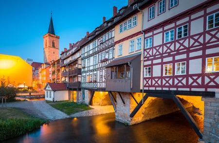 Classic panoramic view of the historic city center of Erfurt with famous Krämerbrücke bridge illuminated at beautiful twilight during blue hour, Thüringen, Germany Stok Fotoğraf