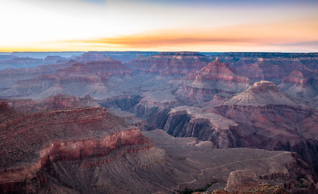 Scenic aerial view of famous Grand Canyon, often considered one of the Seven Natural Wonders of the World, in beautiful post sunset twilight at dusk in summer, Arizona, American Southwest, USA