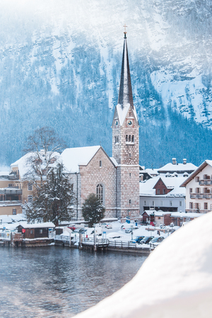 Classic view of famous Hallstatt lakeside town during winter sunrise on a beautiful cold sunny day at Christmas time, Salzkammergut, Austria Stock Photo
