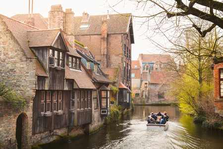 Beautiful view of the historic city center of Brugge, often referred to as The Venice of the North, with tourists taking a boat ride, province of West Flanders, Belgium Stock fotó - 119085844