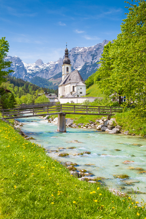 Scenic mountain landscape in the Bavarian Alps with famous Parish Church of St. Sebastian in the village of Ramsau in springtime, Nationalpark Berchtesgadener Land, Upper Bavaria, Germany 写真素材