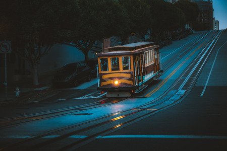 Magical twilight view of historic Cable Car riding on famous California Street at dawn before sunrise, San Francisco, California, USA Stock Photo