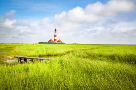 Beautiful view of famous Westerheversand on a sunny day with blue sky and clouds in summer, North Sea, Schleswig-Holstein, Germany