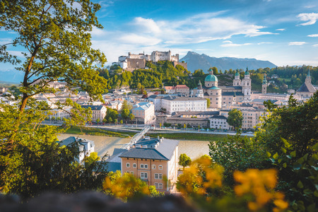 Classic panorama view of the old town of Salzburg, a on a sunny day with blue sky at sunset in summer, Austria, Europe Stock Photo