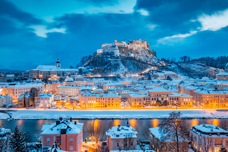 Classic view of the historic city of Salzburg with famous Festung Hohensalzburg and Salzach river illuminated in beautiful twilight during scenic Christmas time in winter, Salzburger Land, Austria 스톡 콘텐츠 - 119086120