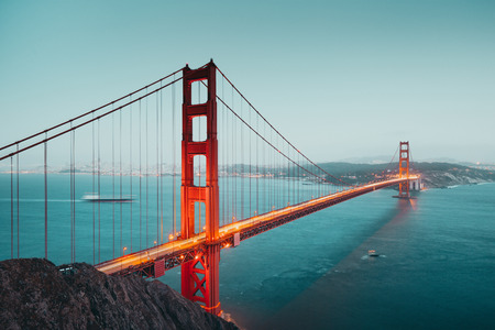 Panoramic view of famous Golden Gate Bridge seen from Battery Spencer viewpoint in beautiful post sunset twilight during blue hour at dusk, San Francisco, USA