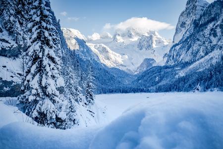 Scenic view of romantic winter wonderland in the Alps with Dachstein glacier in the background, Gosau, Upper Austria region, Austria Stock fotó