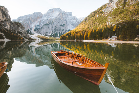 Beautiful view of traditional wooden rowing boat on scenic Lago di Braies in the Dolomites in scenic morning light at sunrise, South Tyrol, Italy Stock Photo - 119086200