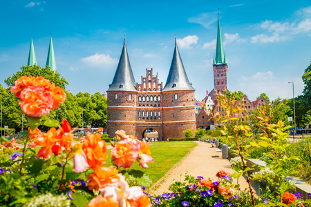 Classic postcard view of the historic town of Lübeck with famous Holstentor gate in summer, Schleswig-Holstein, northern Germany