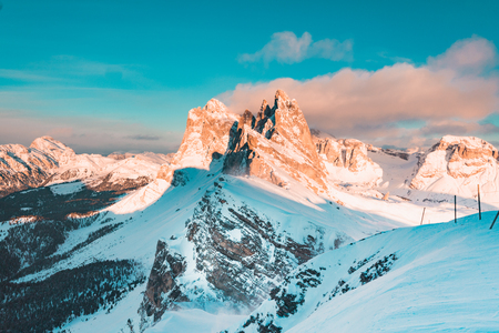 Classic view of famous Seceda mountain peaks in the Dolomites illuminated in beautiful evening light at sunset in winter, South Tyrol, Italy