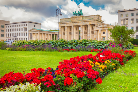 Classic view of famous Brandenburg Gate at Pariser Platz, one of the best-known landmarks and national symbols of Germany, on a beautiful sunny day in summer, central Berlin, Germany
