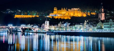 Panoramic view of the old town of Heidelberg reflecting in beautiful Neckar river at night, Baden-Wuerttemberg, Germany Stock Photo