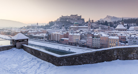 Classic panoramic view of the historic city of Salzburg with Salzach river in beautiful early morning light at sunrise in winter, Salzburg Land, Austria