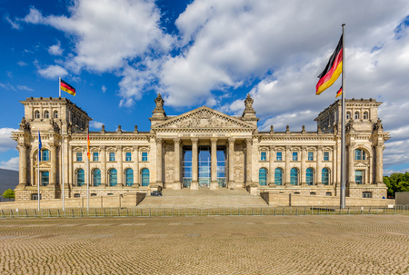 Panoramic view of famous Reichstag building, seat of the German Parliament (Deutscher Bundestag), in beautiful golden evening light at sunset, central Berlin, Germany