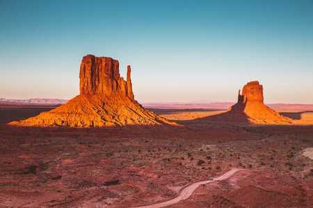 Classic view of famous Monument Valley with the West Mittens shadow being cast on the East Mitten in beautiful golden evening light at sunset, Arizona, USA