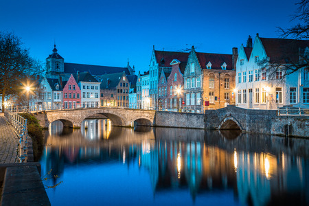 Classic panoramic twilight view of the historic city center of Brugge during beautiful evening blue hour at dusk, province of West Flanders, Belgium Stock Photo