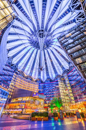 BERLIN - JULY 12: Famous Sony Center at Potsdamer Platz illuminated at night on July 24, 2015 in Berlin, Germany. The modern complex houses shops, restaurants as well as Sonys European headquarters. Redakční
