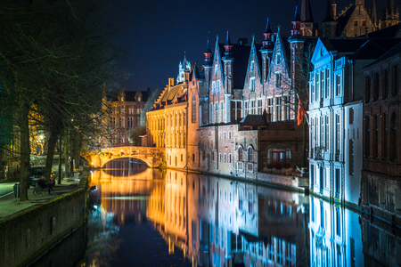 Classic panoramic twilight view of the historic city center of Brugge during beautiful evening blue hour at dusk, province of West Flanders, Belgium Banco de Imagens