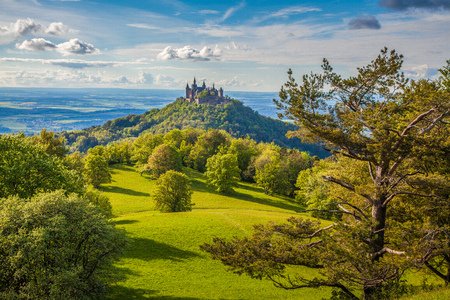 Aerial view of famous Hohenzollern Castle, ancestral seat of the imperial House of Hohenzollern and one of Europes most visited castles, in beautiful golden evening light, Baden-Wurttemberg, Germany