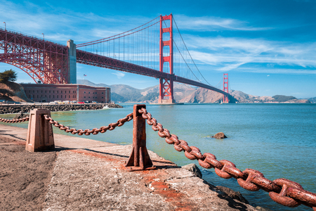 Classic view of famous Golden Gate Bridge with Fort Point National Historic Site on a beautiful sunny day with blue sky and clouds, San Francisco, USA Stock Photo - 119087618