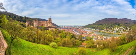 Panoramic view of the old town of Heidelberg with famous Heidelberg Castle on a beautiful sunny day with blue sky and clouds in springtime, Baden-Wuerttemberg, Germany