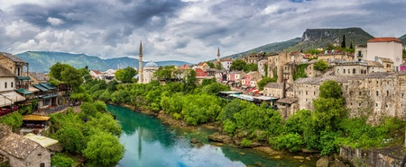 Panoramic aerial view of the historic town of Mostar with famous Old Bridge (Stari Most), on a rainy day with dark clouds in summer, Bosnia and Herzegovina Stock Photo