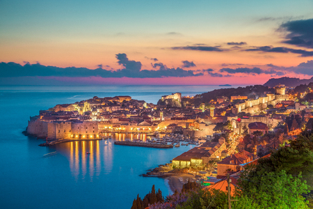 Panoramic aerial view of the historic town of Dubrovnik, one of the most famous tourist destinations in the Mediterranean Sea, in beautiful golden evening light at sunset, Dalmatia, Croatia