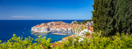 Panoramic aerial view of the historic town of Dubrovnik, one of the most famous tourist destinations in the Mediterranean Sea, from Srt mountain on a beautiful sunny day in summer, Dalmatia, Croatia Sajtókép