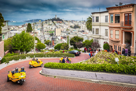 SAN FRANCISCO - SEPTEMBER 3, 2016: Tourist crowds are gathering at famous Lombard Street in central San Francisco, California, USA.