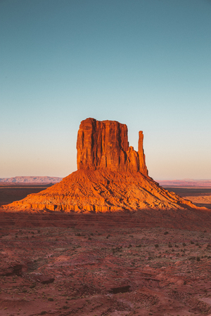Classic view of famous West Mittens in Monument Valley illuminated in beautiful golden evening light at sunset in summer, Arizona, USA