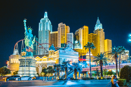 Colorful Downtown Las Vegas with world famous Strip and New York New York hotel and casino complex illuminated beautifully at night, Nevada, USA Imagens - 121806999