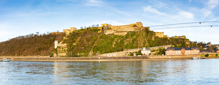 Beautiful view of famous Fortress Ehrenbreitstein with Rhine river in beautiful golden evening light at sunset, Koblenz, Rheinland-Pfalz, Germany
